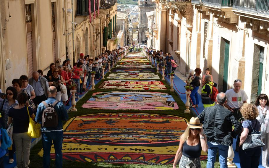 An infiorata is an event in which flowers petals are laid down in intricate patterns to create a temporary work of art. These are organized in Italy during the months of May and June, particularly around the religious holiday of Corpus Christi. This weekend's event in Noto is considered one of the best of its kind.
