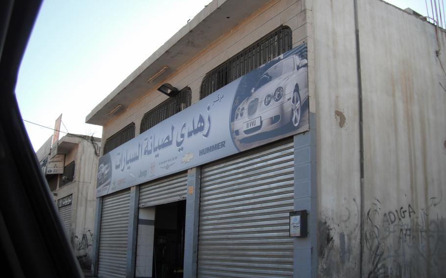 The Land Rover ended up at this unassuming garage in Amman to await repair.