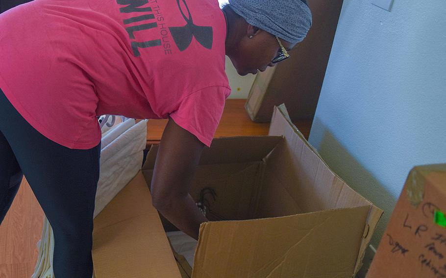 Tami Dugger unpacks boxes in her new home at Dyess Air Force Base, Texas on Aug. 29, 2018.