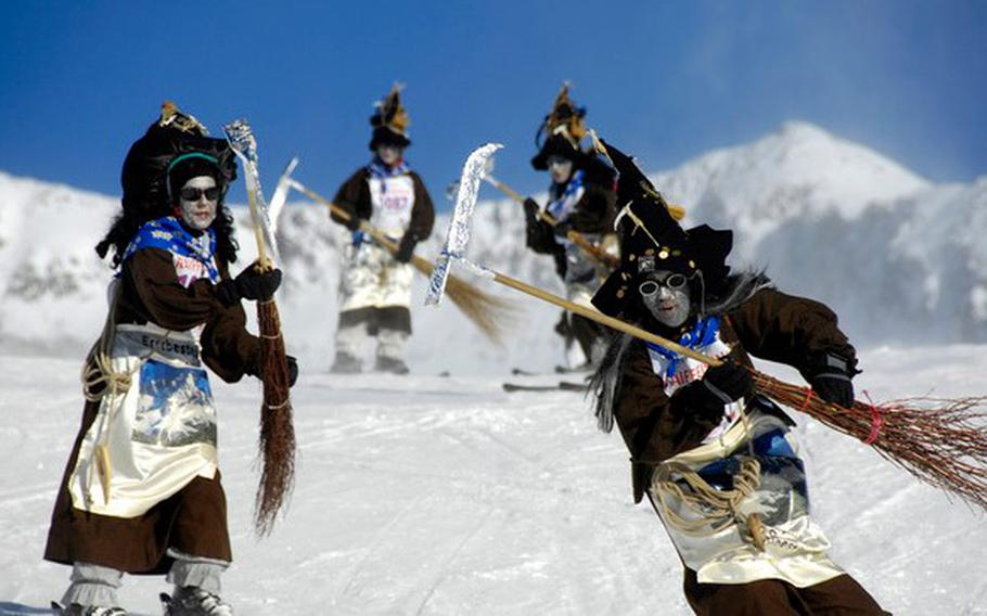 Downhill skiers dressed as witches race along an eight-mile stretch during the Witches Descent near Blatten Belalp, Switzerland. The event takes place Jan. 12-19 this year.