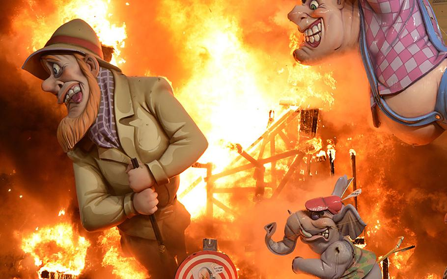 At Valencia's Fallas Bonfire Festival of San Jose, giant cardboard statues known as ninots are set aflame during the crema, a spectacle of light, music and fireworks.