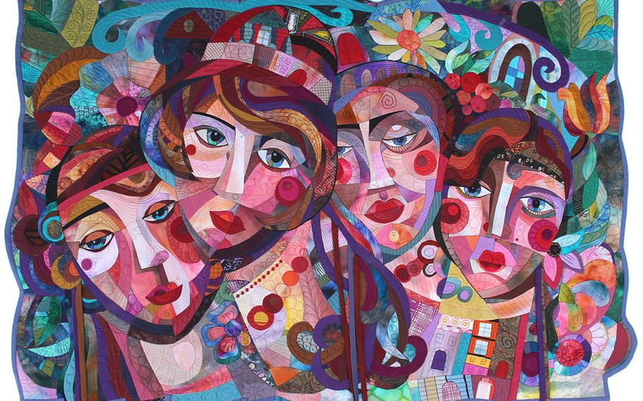 """The European Patchwork Meeting in Ste Marie aux Mines, France, attracts visitors from around the world. More than 1,200 textile works on display reflect past and present trends. This piece is called """"Encyclopedia of imaginary women,"""" by Galla. The event takes place Sept. 12-15."""