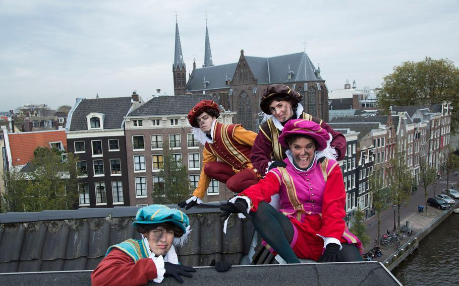 Sinterklaas and his helpmates, the Pieten, arrive Nov. 17 in Amsterdam by means of a half-mile-long water parade, followed by a Grand Parade through the streets.