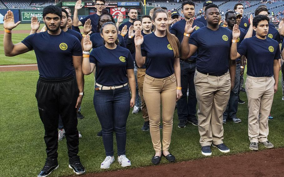 U.S. Navy recruits are sworn in during a ceremony before a Washington Nationals game in 2019.