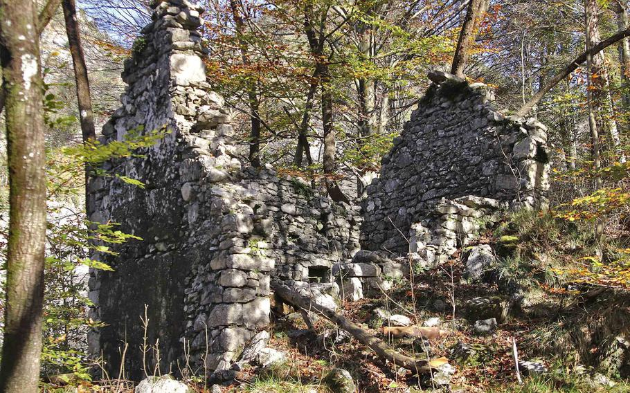 Ruins of an abandoned house in the Italian Alps, along a trail that leads to the ghost towns of Palcoda and Tamar, in Pordenone province, Italy.