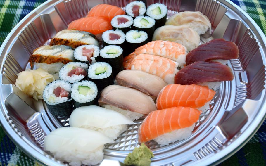 A double sushi combination takeout platter from Hashimoto in Saarbruecken, Germany, on Nov. 15, 2020. The offerings change based on availability. In this case, there was extra salmon and some higher-grade tuna in some of the rolls.