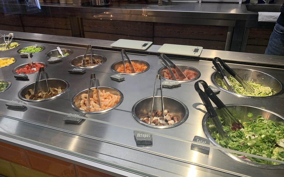 Aloha Poke in Regensburg, Germany, has a variety of toppings to select for a customized poke bowl on Dec. 14, 2020.
