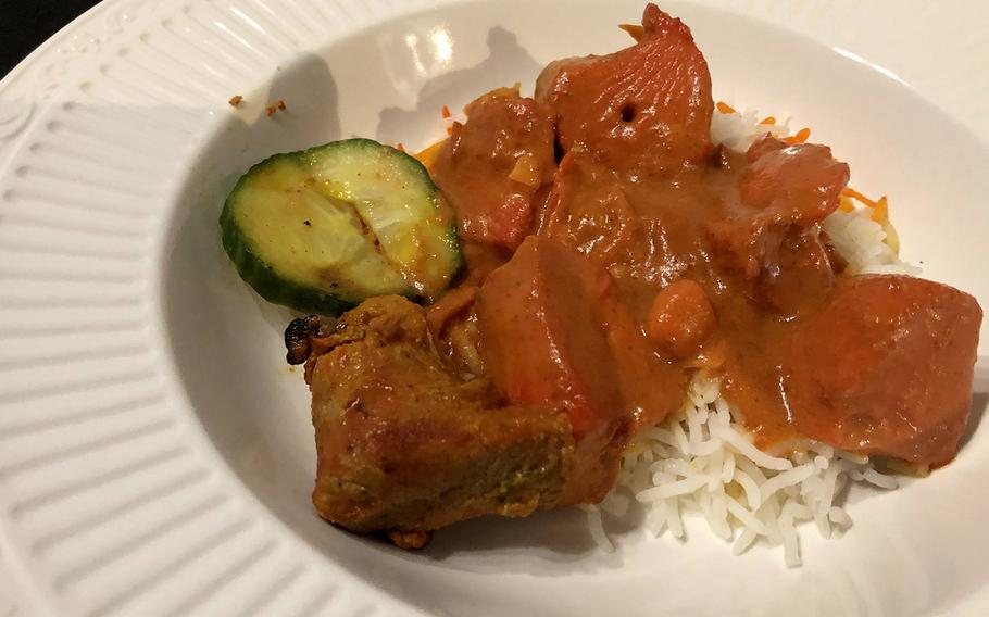 The chicken tikka masala has a slight tomato flavor. It has boneless chicken pieces cooked in a charcoal tandoor oven.