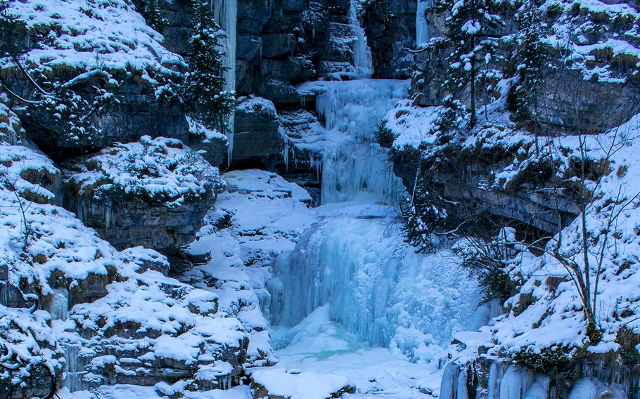 The ice-covered Kuhflucht Waterfall, which is accessed via the ski lift on the Ried in Farchant, makes a picturesque destination in the Zugspitz region of Germany.