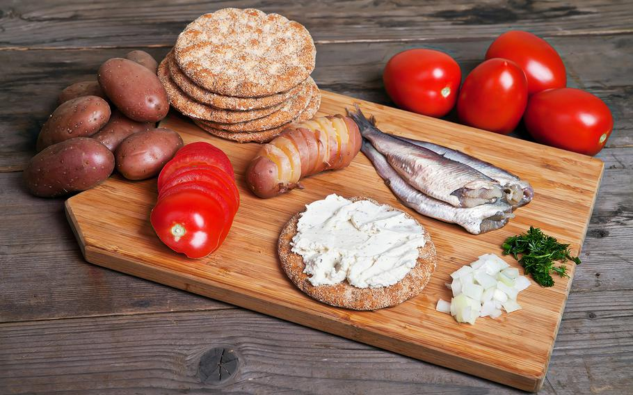 Fermented herring, often served with items such as potato and tomato, is a delicacy in Sweden. Its smell is so strong that it's often consumed outdoors.