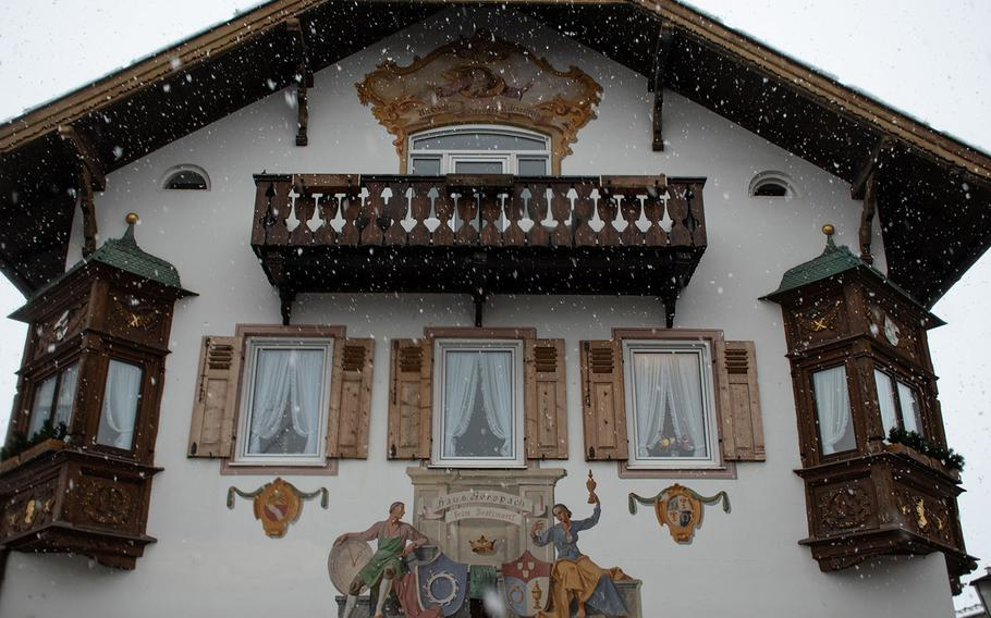 """The facade of Haus Gerspach in Garmisch-Partenkirchen's city center -- photographed during a snowfall -- shows an example of the """"Lüftlmalerei"""" mural art found in rural areas in Bavaria."""