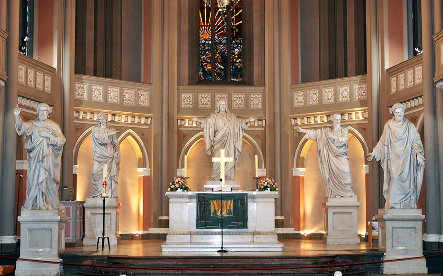 Statues of Jesus Christ and the four Evangelists, Matthew, Mark, Luke and John, who are said to have written four of the gospels in the New Testament of the Bible, overlook the altar in the Marktkirche in Wiesbaden, Germany.