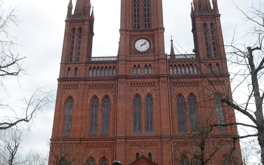 The Marktkirche, or market church, in Wiesbaden, Germany, was built between 1853 and 1862 in the neo-Gothic style, characterized by its stone and brick structures, heavy decoration, pointed arches, steep gables, and large windows.