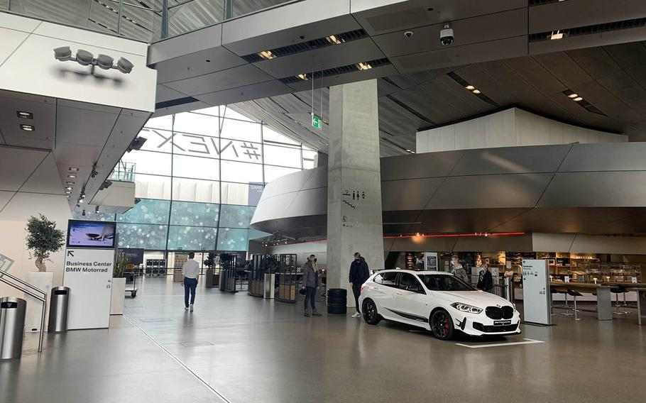 The main floor of the BMW Welt in Munich, Germany, Oct. 14, 2020. The main floor of the museum features showroom cars, a coffee shop and gift shop. The BMW Welt is scheduled to reopen its doors on March 7, 2021.