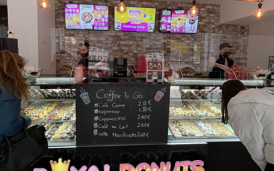 Customers inside Royal Donuts in Regensburg, Germany, face some tough decisions.