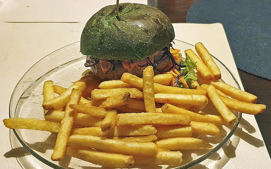 The ''Hulk'' burger from Sacellum-Cucineria Urbana in Sacile, Italy.The green bun is made with chlorophyll and the 7-ounce patty is stuffed with cheddar cheese.