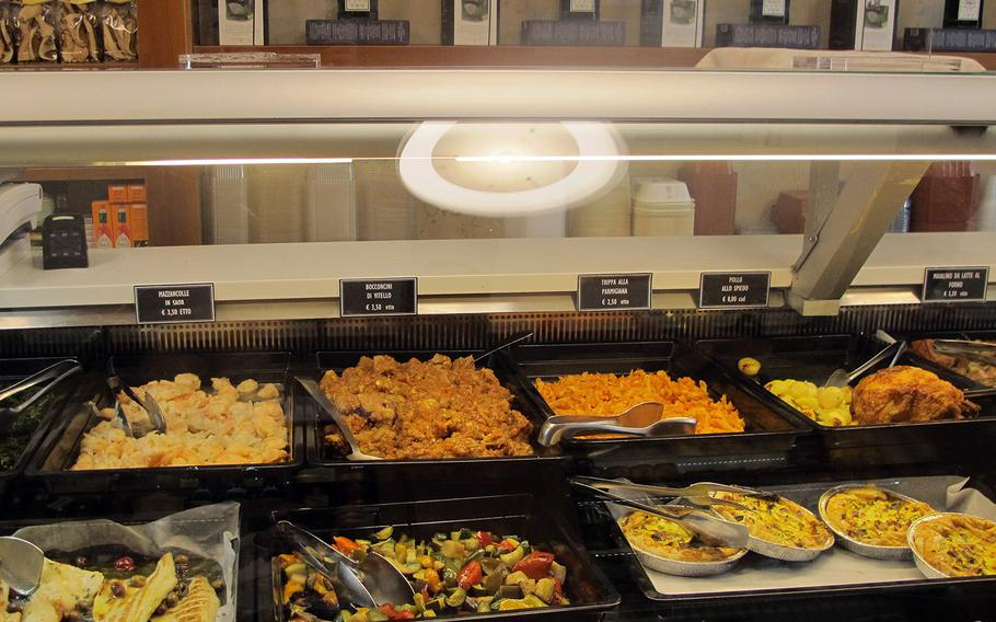 A partial selection of prepared foods in Il Ceppo's daily selection of fish, meat and poultry main dishes, along with pasta, potato and vegetable sides. There's nearly always something that looks good for dinner in the Vicenza shop.