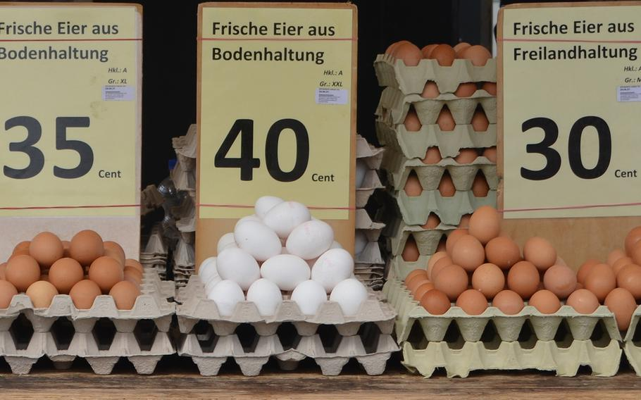The egg stand in the outdoor market in Kaiserslautern, Germany, sells, from left to right, ''bodenhaltung'' eggs laid by chickens kept indoors, and ''freihaltung'' eggs from free-range chickens. ''Bio,'' or organic eggs, are also available.