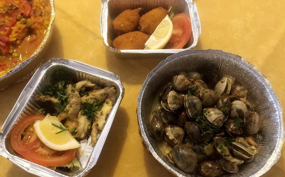 The three tapas we enjoyed from Casa Algarve in Griesheim were, clockwise from top, crabmeat croquettes, clams in white wine with garlic and fried anchovies. Rabbit paella is at top left.