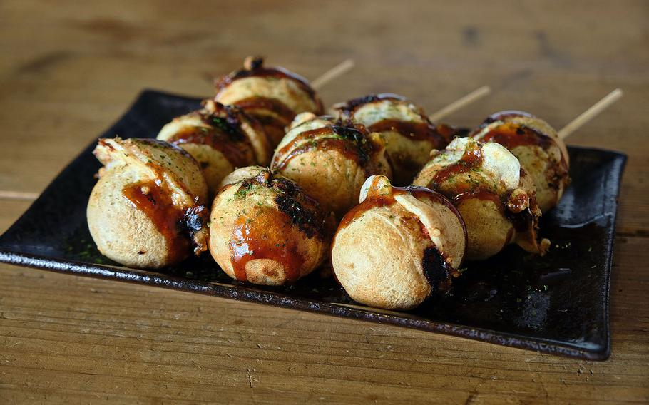 Eight, a takoyaki shop in Yokosuka, Japan, offers a variety of flavors, including bacon and cabbage, ginger garlic poke, Chinese chive and dried shrimp, kimchi and cheese, corn and bacon, and tofu.