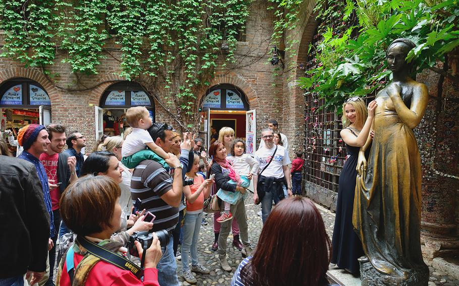 The Juliet statue in Verona, Italy, is one of the town's most popular and symbolic tourist attractions. Visitors take turns touching the right breast of the statue for luck. Or at least for a selfie.