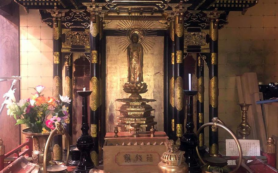 Hotaru, a 250-year-old temple that now serves as an inn in Urasa, Japan, is filled with altars and Buddhist artwork.