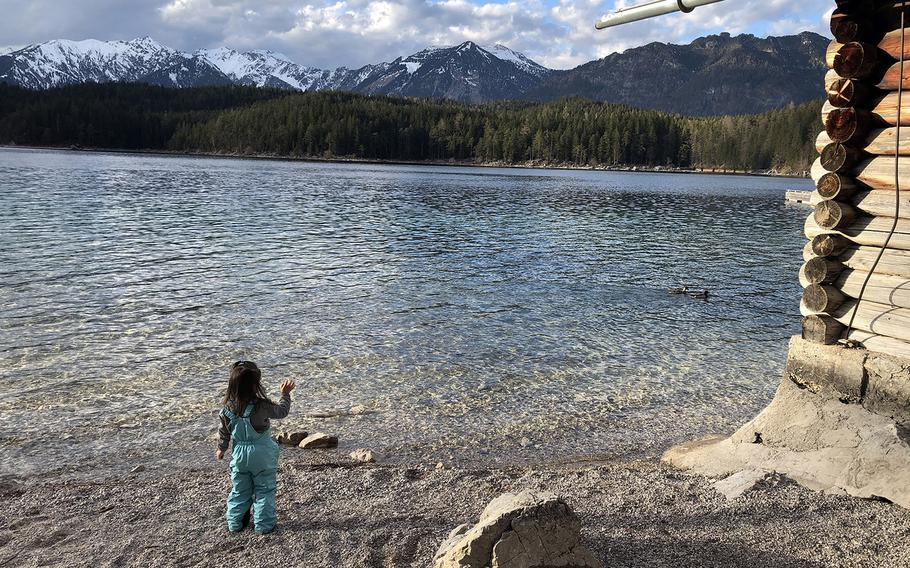 A girl throws a rock into the Eibsee, a lake at the northerly base of the Zugspitze, Germany's tallest mountain, in March 2020. The lake includes a gentle hiking course and plenty of vantage points to take in the stunning scenery.