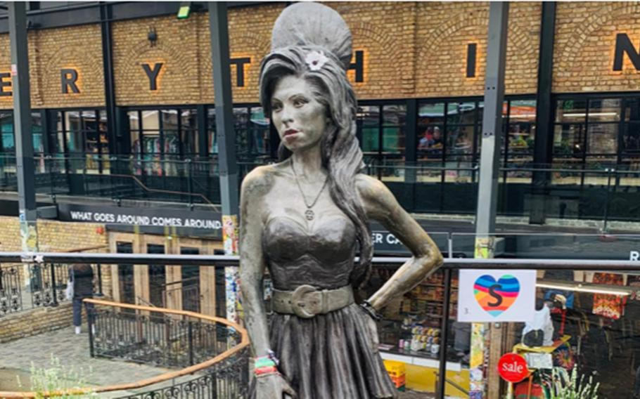 A life-sized statue of singer Amy Winehouse graces the Stables Market in London's Camden Town district.