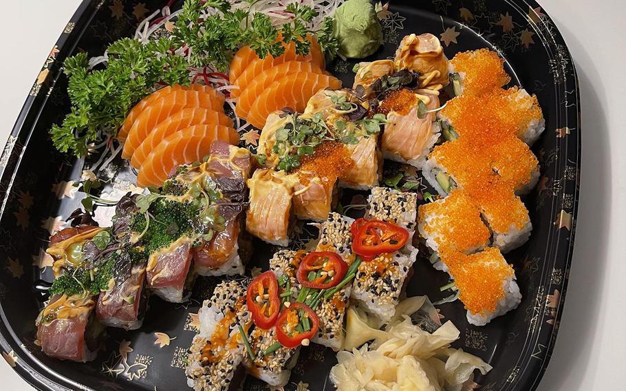 A variety of items from Kokoro including salmon sashimi, pirikara, California, momo and midori rolls.