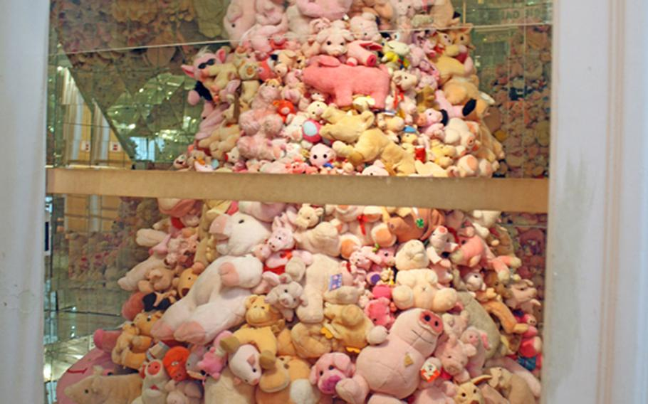 A pyramid of stuffed pigs are among the displays at the Schweine Museum in Stuttgart, Germany, billed as the world's largest museum devoted to swine. The museum features 50,000 pig objects of various shapes and sizes.