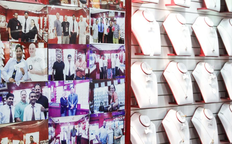 Many shop owners in the Manama Souq show their pride in doing business with U.S. personnel in Bahrain by displaying pictures and the business cards of previous American customers.