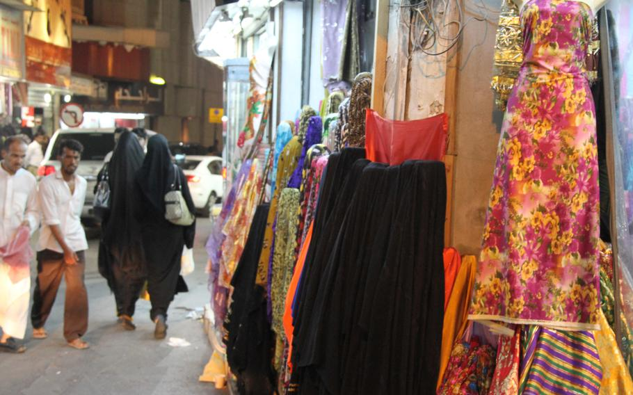 The Manama Souq features many shops that sell colorful traditional dresses and fabrics.