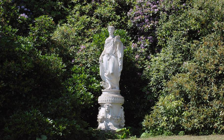 A statue is nestled in the trees around the palace lawn at Bergpark Wilhelmshöhe in Kassel, Germany. Though some of the park's features were under renovation in June 2015, the site still has plenty to offer visitors.