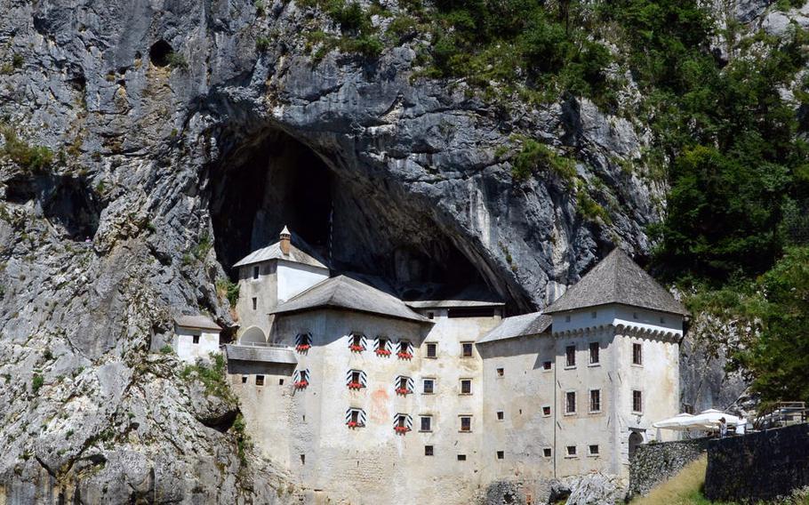 One of Slovenia's hidden treasures, Predjama Castle is tucked away in the mouth of a cave near the village of Predjama, Slovenia.