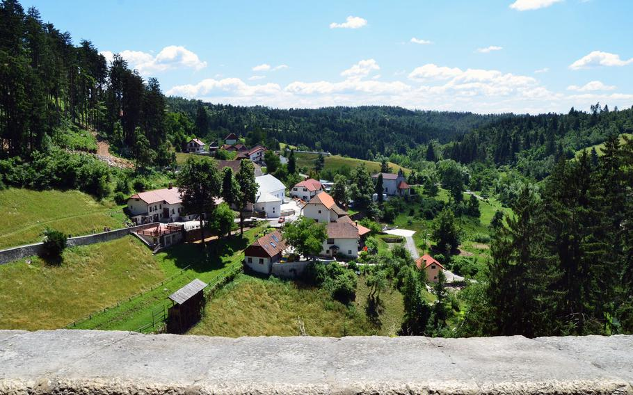 This picture offers a view of Predjama, Slovenia, from Predjama Castle's uppermost level, the terrace.