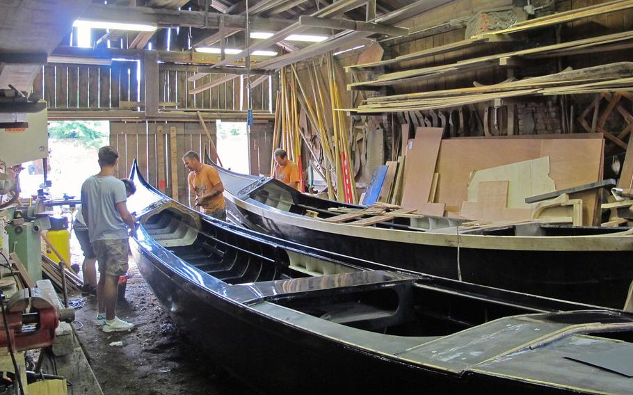 Boat wrights work on gondolas in one of Venice's few remaining boat yards, on San Trovaso Square in the Dorsoduro district.