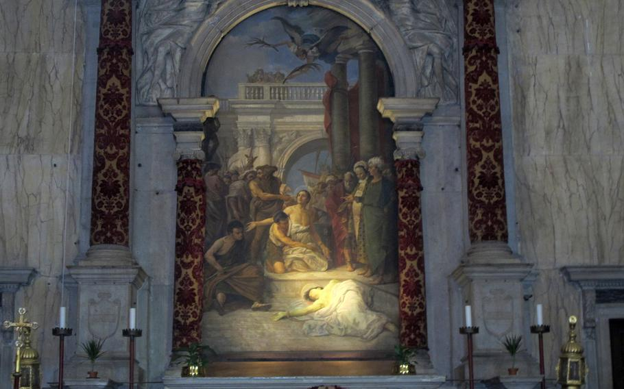 This painting in the San Trovaso church in the Dorsoduro district of Venice, reminicient of Caravaggio, is actually by a Venetian artist named Giuseppe Ponga, who died in 1925.