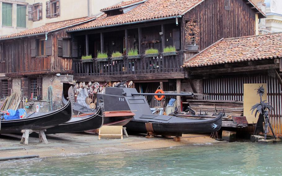The boat house in Venice's San Trovaso Square is constructed of wood, as are gondolas.