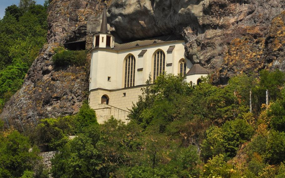 The Felsenkirche - or Church in the Rock - sits about 200 feet above Idar-Oberstein, Germany, built inside a natural niche along a towering rock face.
