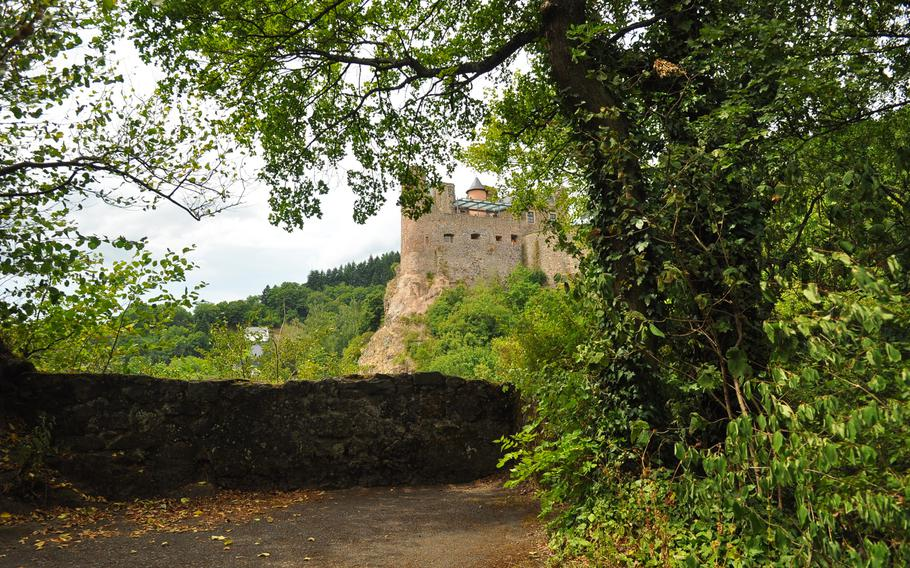 Oberstein Castle looms in the distance from a vantage point along the paved trail to the castle, in Idar-Oberstein, Germany.