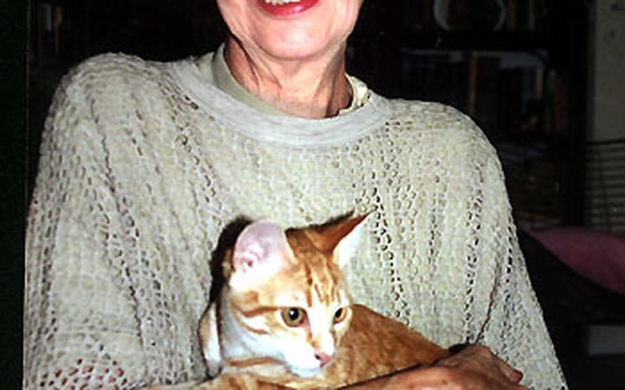 Sigrid Ruckaberle with a young cat that someone brought to her as a homeless kitten from Spain.