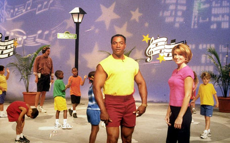 A promotional poster for the children's exercise video Movin' & Groovin' shows Air Force Staff Sgt. Tony Webb and aerobics instructor Linda Harris posing on one of the sets they used to lead a series of exercise routines.