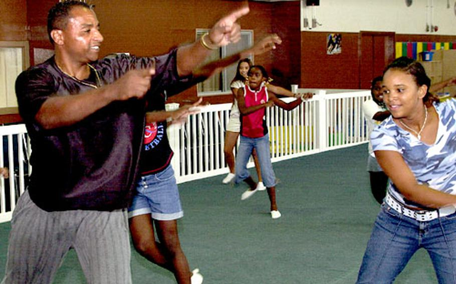 Staff Sgt. Tony Webb uses the Movin' & Groovin' video, in which he co-stars, to lead a group of youngsters at Kadena Air Base in a 30-minute Saturday workout.