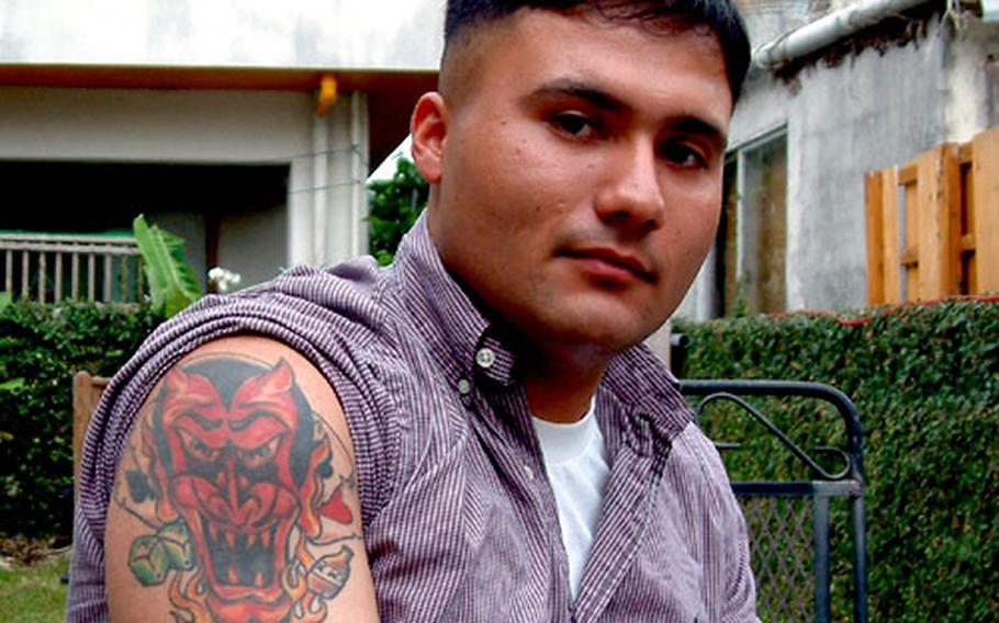 """Tattoos are a form of self expression, says Marine Lance Cpl. Chris Mena, who visited Coko's to get the letters RTTG — meaning """"Race to the Grave"""" — tattooed on his inner lip."""