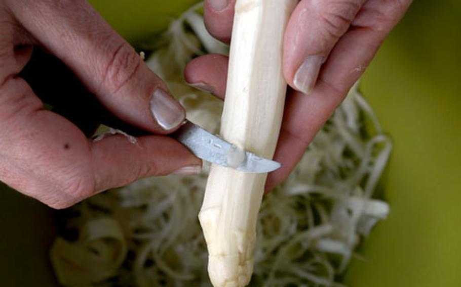 Experts say it's best to peel asparagus back from the tip. The peels can be used to cook asparagus soup.