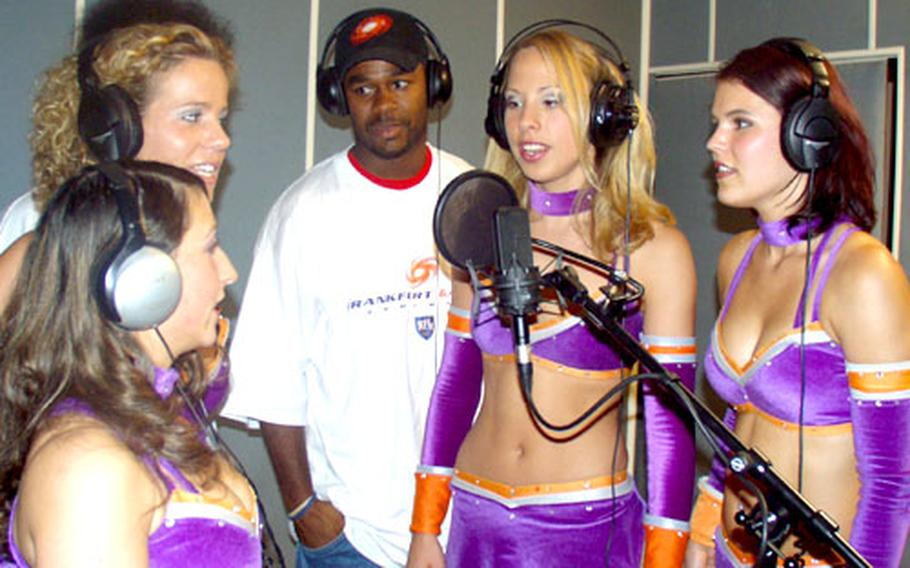 """Frankfurt Galaxy cheerleaders — from left to right, Sibel, Cindy, Anne, and Jenny S. — cheer during """"Here We Come"""" by A.K.-S.W.I.F.T. Defensive player Calvin Spears helped rap portions of the song, which debuted during the team's May 10 game."""