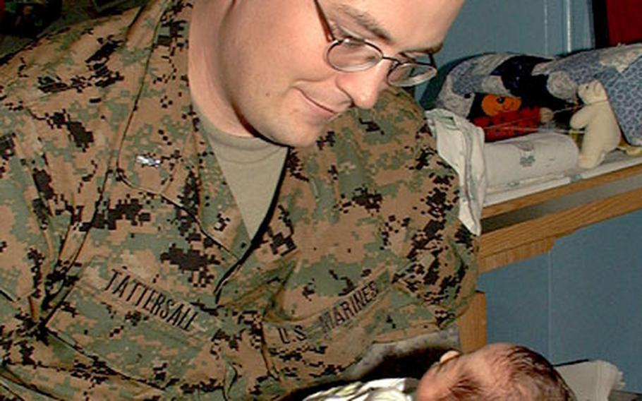 Marine 1st Lt. Brandon Tattersall holds his son, Evan Bradley Tattersall. Born just shy of 3 pounds, Tattersall was initially wary of holding his son, born seven weeks premature.