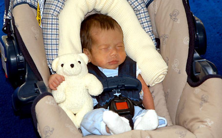 Evan Tattersall, though tiny in his car seat, is ready for his first ride home.