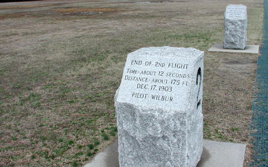 Markers show the distance traveled in each of the Wright brothers' flights on Dec. 17, 1903. The fourth and final flight went 852 feet.