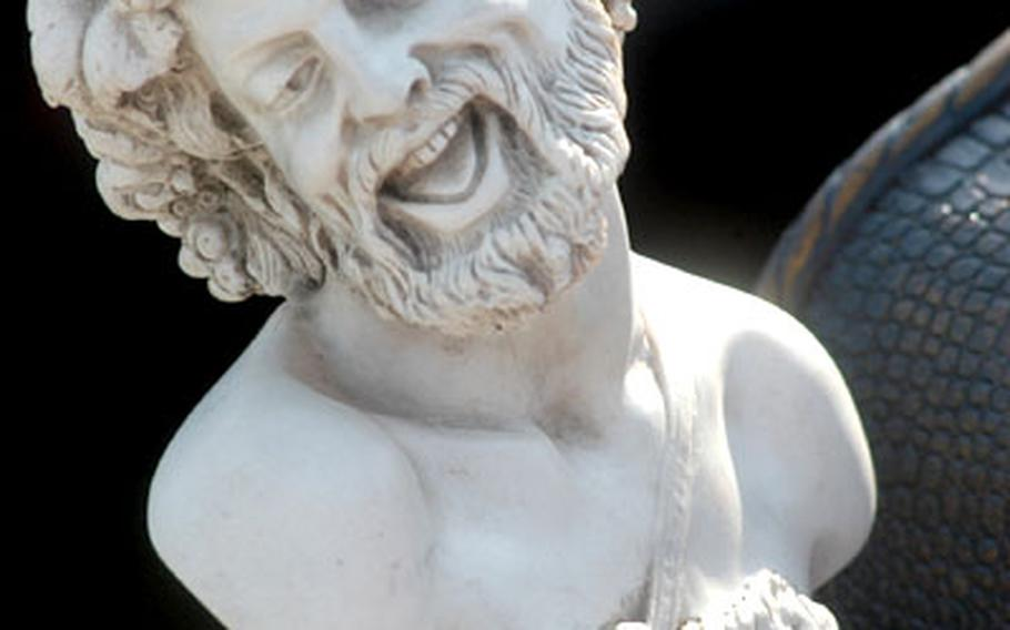 Car boot sales in England are nothing to laugh about. They attract many sellers and plenty of buyers every weekend around the country, looking for items they just can't live without, like the jolly statue shown here.